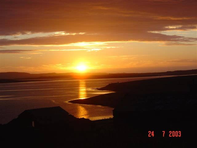 Sun setting behind Westray, from Eday
