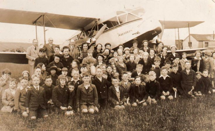Schoolchildren and plane